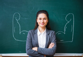 smiling young teacher near the board
